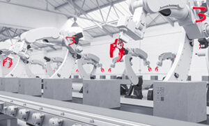 Robot gripper arms reach for paskets on a conveyor belt to symbolize automation for Axivion.